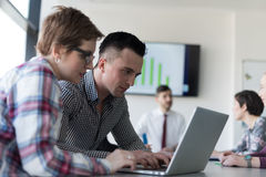 Young business couple working on laptop, businesspeople group on Royalty Free Stock Image
