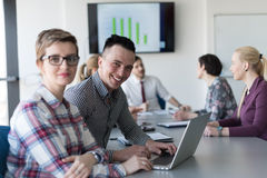 Young business couple working on laptop, businesspeople group on Stock Photo