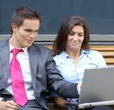 A young business couple is working outdoors Stock Photography