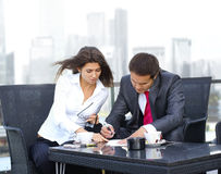 A young business couple is working outdoors Royalty Free Stock Image