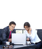 A young business couple working together Stock Images