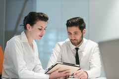 Young business couple working together on project Royalty Free Stock Photography