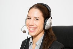 Young business dressed female working as telemarketer Royalty Free Stock Photography