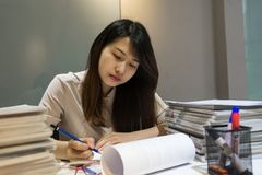 Young business employee take note into reports royalty free stock photography