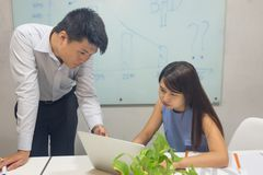 Young business employees discuss about work in the office royalty free stock image