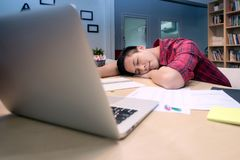 Young business entrepreneur sleeping after work stress. To find out new business ideas at home office.Conceptual for startup small businesses entrepreneur and Royalty Free Stock Photography