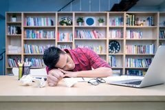 Young business entrepreneur sleeping after work stress. To find out new business ideas at home office.Conceptual for startup small businesses entrepreneur and Royalty Free Stock Photo