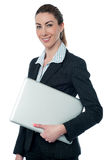 Young business executive with laptop Royalty Free Stock Image