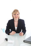 Young business executive sitting at her desk Royalty Free Stock Photo