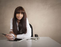 Young business executive working at desk with digital tablet Stock Photos