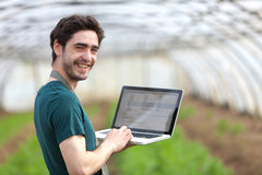 Young business farmer working on his laptop Stock Photos