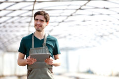 Young business farmer working on his tablet Royalty Free Stock Image