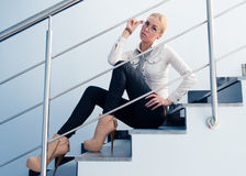 Young business fashion woman sitting on stairs Stock Image