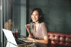 Young business female hands using smart phone while working on computer laptop stock photo