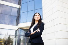 Young business girl in front of modern business offices center stock photo