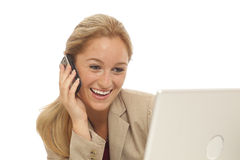 Young business girl using cell phone Royalty Free Stock Photo