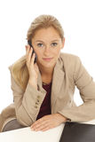 Young business girl using cell phone Royalty Free Stock Image