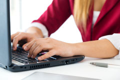 Young business girl using her computer. Royalty Free Stock Photos