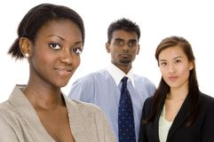 Young Business Group. A diverse young business team - Focus on woman in front Stock Images