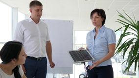 Young business group negotiate natural energy and development solar battery. In modern office stock footage