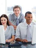Young business group working at a computer Stock Image