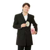 Young business holding piggy bank and dollars  Stock Images