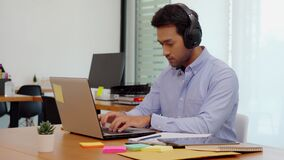 Young business indian man meeting with business team via video conference call at office
