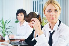 Young business ladies working in office Stock Image