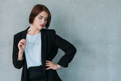 Young attractive business lady posing eyes down royalty free stock image