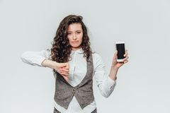 Young business lady with beautiful curly hair on a white background royalty free stock images
