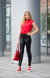 Young business lady in black pants, red blouse, fashion bag and Stock Images