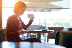 Young business lady in cafe stock image