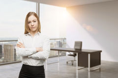 Young business lady with crossed hands in the office. CEO at the working place in modern panoramic New York office. Cons Stock Images