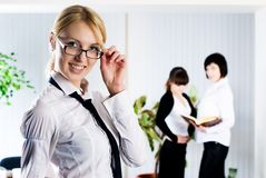 Young business lady at office background Royalty Free Stock Photos