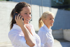 Young business lady with phone in the street Stock Photos