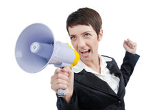 Young business lady screaming. To loudspeaker Royalty Free Stock Image