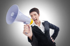 Young business lady. Screaming to loudspeaker Royalty Free Stock Photography