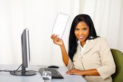 Young business lady showing a letter Royalty Free Stock Image