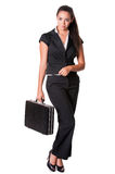 Young business lady stands with briefcase Royalty Free Stock Image