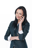 Young business lady talking by phone and smile. royalty free stock photo