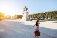 Woman traveling in Montpellier city, France. Young business lady walking with bag at the Peyrou park during the morning light in Montpellier city in France. Wide stock image