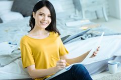 Young business lady working on project at home. Success is your choice. Happy young woman looking into the camera with a cheerful smile on her face while stock images