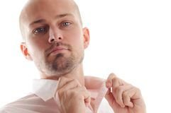 Young Business Man. Portrait of a Young Man with pink shirt and white background Royalty Free Stock Photography