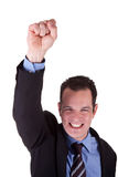 Young Business Man. Young bussiness man with arm raised in victory sign Stock Images