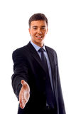 Young business man. Young businessman greeting with handshake isolated on white royalty free stock photo