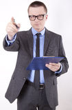 Young business man. Pointing with his finger Stock Image