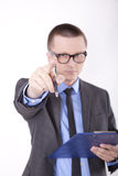 Young business man. Pointing with his finger Stock Images