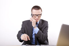 Young business man. Talking on a phone Royalty Free Stock Images