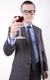 Young business man. With a glass of wine Royalty Free Stock Photos