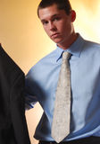 Young business man 3. Young business man staring into the camera wearing a blue shirt and paisley tie Stock Image
